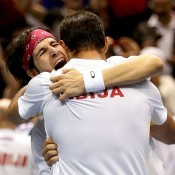 Ilija Bozoljac of Serbia celebrates with partner Nenad Zimonjic, delighted at upsetting the Bryan brothers in the doubles rubber of the USA v Serbia Davis Cup tie in Boise, Idaho; Getty Images