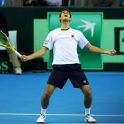 James Ward of Great Britain celebrates his victory over Dmitry Tursunov of Russia in the Davis Cup tie in Coventry, England; Getty Images