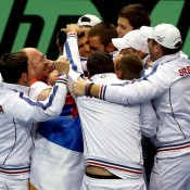 Novak Djokovic of Serbia celebrates his win in the decisive fourth rubber against Sam Querrey with his teammates during the USA v Serbia Davis Cup tie in Boise, Idaho; Getty Images