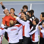Tatsuma Ito (in red) of Japan is swamped by teammates after winning his match in the Japan v South Korea Davis Cup Asia/Oceania Group I second round tie at Ariake Colosseum in Tokyo; Getty Images