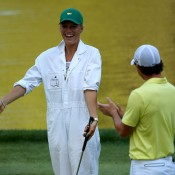Rory McIlroy of Northern Ireland applauds caddie and girlfriend Caroline Wozniacki as she tries her hand with the clubs during the Par 3 Contest prior to the 2013 US Masters at Augusta National Golf Club; Getty Images