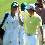 Rory McIlroy of Northern Ireland walks with his caddie and girlfriend Caroline Wozniacki during the Par 3 Contest prior to the start of the 2013 Masters Tournament at Augusta National Golf Club; Getty Images