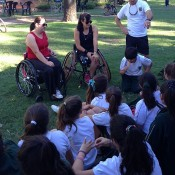 Sarah Calati (R) and Luba Josevski talk to school students in Argentina; Tennis Australia