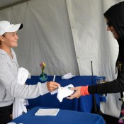 Ash Barty signs an autograph for a fan on Day 5 of the Family Circle Cup in Charleston; Chris Smith/Family Circle Cup