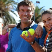 Pat Cash at the Gallipoli Youth Cup media event at Melbourne Park with 2012 tournament champion Ellen Perez (L) and Sera Yavuzcan (R); Tennis Australia