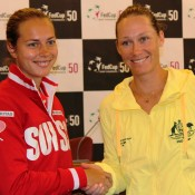 Stefanie Voegele (L) and Sam Stosur will open the Switzerland v Australia Fed Cup World Group Play-off tie in the first singles match on Saturday at Tennis Club Chiasso in Switzerland; Tennis Australia