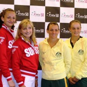 The Swiss and Australian Fed Cup teams pose for photos at the official draw ceremony ahead of their World Group Play-off tie on 20-21 April at Tennis Club Chiasso in southern Switzerland; Tennis Australia