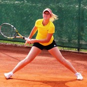 Storm Sanders slides into a shot on the red clay of Tennis Club Chiasso during an Australian Fed Cup team practice session; Tennis Australia