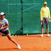 Ash Barty (L) practises on the red clay of Tennis Club Chiasso as Australian Fed Cup captain Alicia Molik looks on; Tennis Australia