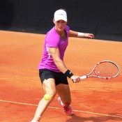 Sam Stosur slides into a backhand on the red clay of Tennis Club Chiasso ahead of Australia's Fed Cup World Group Play-off tie against Switzerland on 20-21 April; Tennis Australia