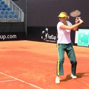 Australian Fed Cup captain Alicia Molik hits with her team on the red clay of Tennis Club Chiasso ahead of Australia's tie against Switzerland on 20-21 April; Tennis Australia