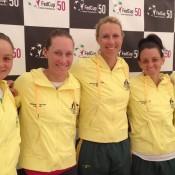 Australia's Fed Cup team of (L-R) Ash Barty, Sam Stosur, captain Alicia Molik, Casey Dellacqua and Jarmila Gajdosova don new team outfits at a pre-tie press conference in Chiasso, Switzerland; Tennis Australia