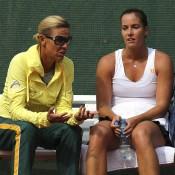 Jarmila Gajdosova (R) of Australia speaks to Fed Cup coach Nicole Bradtke during her match against Romina Oprandi; Getty Images