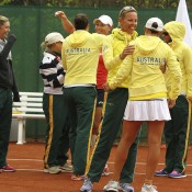 Australia's tennis team celebrates its victory over Switzerland in the Fed Cup World Group Play-off tie between Switzerland and Australia at Tennis Club Chiasso; Getty Images