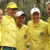 (L-R) Jarmila Gajdosova, captain Alicia Molik, Ashleigh Barty, Sam Stosur and coach Nicole Bradtke of Australia celebrate their Fed Cup victory over Switzerland in Chiasso, Switzerland; Getty Images