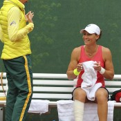 Sam Stosur (R) chats to Australian Fed Cup coach Nicole Bradtke during her match against Romina Oprandi; Getty Images