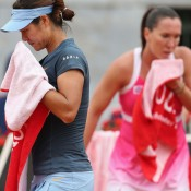 Li Na (L) and Jelena Jankovic reach for the towels in their epic third round match at the Internazionali BNL d'Italia, which Jankovic won 7-6(2) 7-5; Getty Images