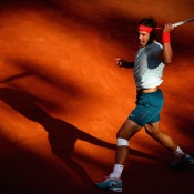 Rafael Nadal emerges from the shadows on Campo Centrale during his quarterfinal victory over David Ferrer at the Internazionali BNL d'Italia; Getty Images