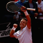 Tomas Berdych punches the air in delight as he celebrates ending an 11-match losing streak to Novak Djokovic in the quarterfinals of the Internazionali BNL d'Italia in Rome, Italy. Berdych was down 6-2 5-2 before recovering to win; Getty Images