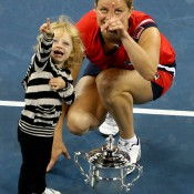 Kim Clijsters and daughter Jada pose with the championship trophy after Clijsters won the 2009 US Open, incredibly in just her third tournament into her comeback after giving birth. The Belgian retired for good at the 2012 US Open and has since announced she is pregnant with a second child; Getty Images