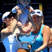 Cara Black (L) of Zimbabwe poses with her son Lachlan (born April 2012) and Anastasia Rodionova of Australia (R) after winning their doubles final at the 2013 ASB Classic in Auckland, New Zealand; Getty Images