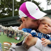 Lindsay Davenport kisses her first baby Jagger (born in June 2007) after winning the singles title at the 2008 ASB Classic in Auckland, New Zealand. Davenport withdrew from Australian Open 2009 and announced she was again pregnant, and this time gave birth to a baby girl (Lauren) in June. She then played some tour-level doubles events, as well as Legends Doubles and World Team Tennis, before giving birth to a third child, Kaya, in January 2012; Getty Images