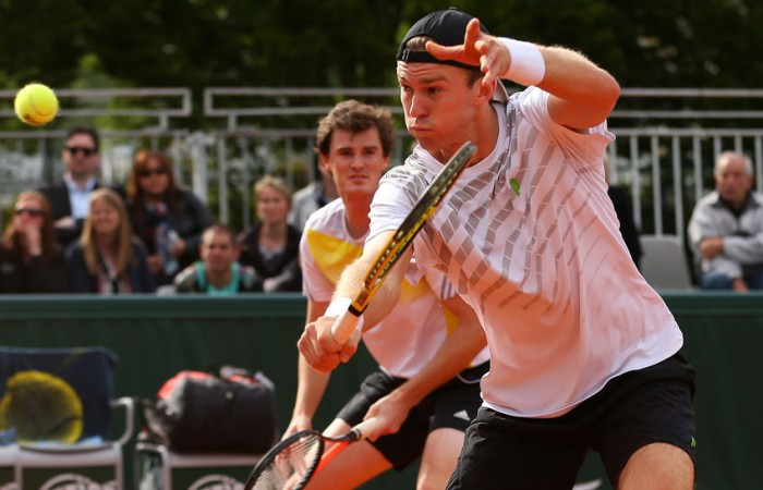 John Peers of Australia plays a backhand volley alongside British partner Jamie Murray in their first round doubles win over Julian Knowle of Austria and Filip Polasek of Slovakia on Day 4 of the French Open; Getty Images