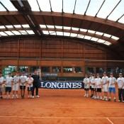 Rinky Hijikata (next to Fabrice Santoro) poses during training with the other competitors ahead of the Longines Future Tennis Aces event in Paris; Tennis Australia