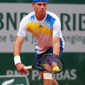 James Duckworth serves to Blaz Kavcic of Slovenia during their first round match on Day 1 of the French Open at Roland Garros in Paris, France; Getty Images