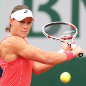 Sam Stosur, playing a backhand in her first round match against Kimiko Date-Krumm of Japan on Day 3 of the French Open, won the opening set in just 21 minutes and raced to a 6-0 3-0 lead; Getty Images