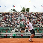 Lleyton Hewitt serves to Gilles Simon during their first round match on Court Suzanne Lenglen on Day 1 of the French Open at Roland Garros in Paris, France; Getty Images