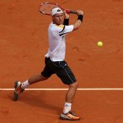 Lleyton Hewitt volley in his first round match against Gilles Simon at the French Open at Roland Garros in Paris, France; Getty Images