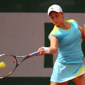 Ash Barty, playing a forehand in her first round match at the French Open, overcame the loss of the second set against Lucie Hradecka of Czech Republic to win her first Grand Slam match 7-5 2-6 6-1 on Day 4 at Roland Garros in Paris, France; Getty Images