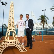 Todd Woodbridge (R) poses with emerging Aussie junior Marc Polmans at Melbourne Park's clay courts at a French Open preview event; Tennis Australia