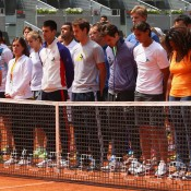 ATP and WTA players in Madrid stand together for a minute's silence to honour Brad Drewett. GETTY IMAGES