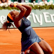 Serena Williams collapses to the court in delight after beating Maria Sharapova 6-4 6-4 in the French Open women's singles final at Roland Garros on June 8 in Paris, France. With the victory, she became the oldest French Open champion in the Open Era; Getty Images