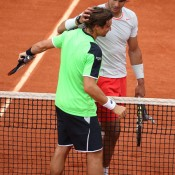 Rafael Nadal embraces opponent David Ferrer at the net following the French Open men's singles final at Roland Garros, which Nadal won 6-3 6-2 6-3; Getty Images