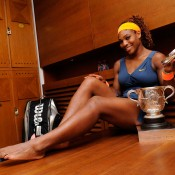 Serena Williams poses with the Coupe Suzanne Lenglen in her changing room following her defeat of Maria Sharapova in the French Open women's singles final at Roland Garros; Getty Images