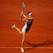 Maria Sharapova plays a backhand in the French Open women's singles final against Serena Williams at Roland Garros in Paris, France; Getty Images