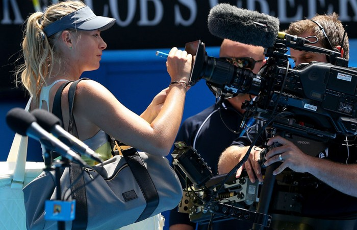 Maria Sharapova signs the camera at Australian Open 2013. GETTY IMAGES
