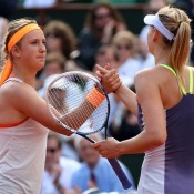 Maria Sharapova (R) shakes hands at the net with Victoria Azarenka after winning their 2013 French Open semifinal at Roland Garros; Getty Images