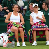 Casey Dellacqua and Ash Barty take a break during their 6-2 7-5 win over Valeria Solovyeva and Maryna Zanevska. GETTY IMAGES