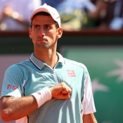 Novak Djokovic in action during the 2013 French Open at Roland Garros in Paris, France; Getty Images