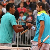 Marin Cilic (R) of Croatia is congratulated by Nick Kyrgios after Cilic won their second round match on Day 4 of the French Open at Roland Garros in Paris, France; Getty Images