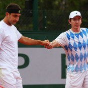 Australians Marinko Matosevic (L) and John-Patrick Smith celebrate a point in their men's doubles first round loss to Frenchmen Jonathan Dasnieres de Veigy and Florent Serra at the French Open; Getty Images