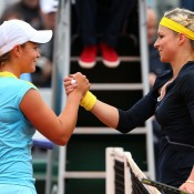 Following their rain-delayed second round match, Maria Kirilenko (R) of Russia shakes hands with Ash Barty after defeating the Australian 6-3 6-1 on Day 6 the French Open at Roland Garros; Getty Images