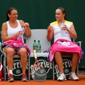 Casey Dellacqua (L) and Ashleigh Barty talk at a changeover during their three-set first round doubles loss to Mona Barthel of Germany and Liga Dekmeijere of Latvia on Day 6 of the French Open; Getty Images