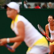 Despite fighting hard, Casey Dellacqua (R) and Ashleigh Barty (foreground, blurred) went down 3-6 6-4 6-3 to Mona Barthel of Germany and Liga Dekmeijere of Latvia  in the first round of the women's doubles at the French Open; Getty Images