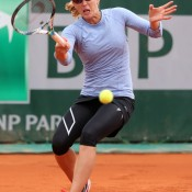 Anastasia Rodionova of Australia plays a forehand during her 6-1 6-1 second round women's doubles win with Russian partner Alla Kudryavtseva over Catalina Castano of Columbia and Katalin Marosi of Hungary on Day 6 of the French Open; Getty Images