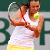 Casey Dellacqua plays a backhand in her first round doubles match with Ashleigh Barty at the French Open; Getty Images